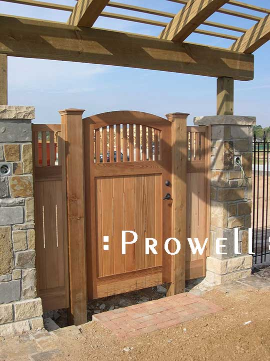 wood gate with flanking panels