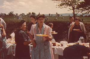 Charles' great grandmother 'Ma', in the church parking lot following service. In the background the Big Ridge cemetery where Charles' father would soon lie to rest.
