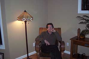 Visiting cousin Sally, seated in Charles' great-grandmother's rocker (Ma's chair)