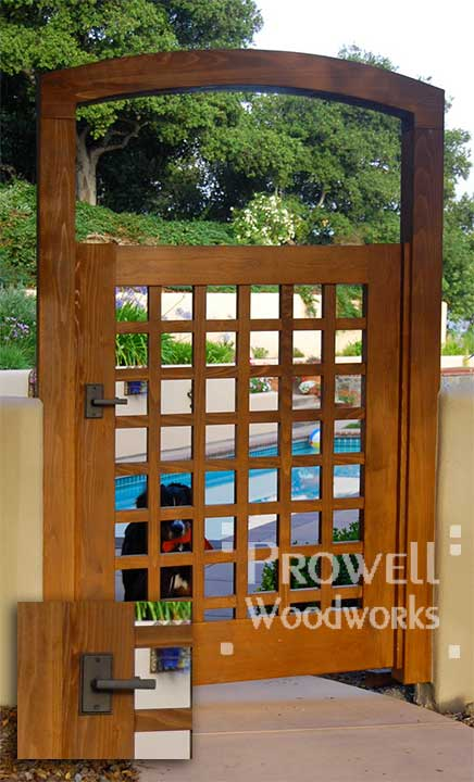 wood gate with bronze latch