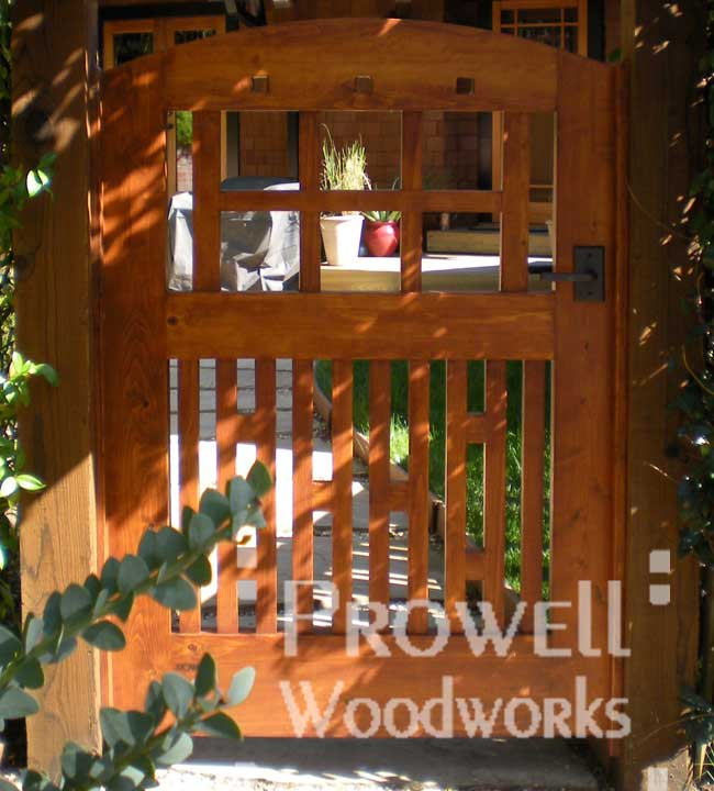 custom wood gate with bronze gate atches