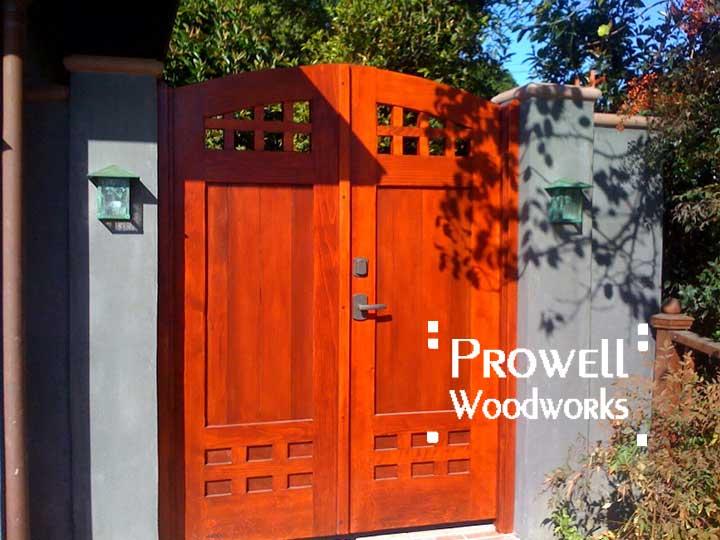 wood gate with bronze gate latch