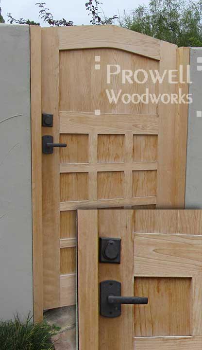 custom wood gate with bronze gate hardware