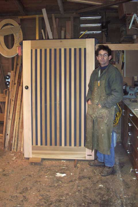 photo showing charles prowell building the picket gate #32. 1993
