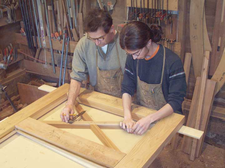 shop photo showing charles and ben prowell building wood gate #51
