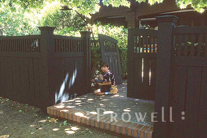 Ben prowell installing a wood fence panel in Marin County, CA
