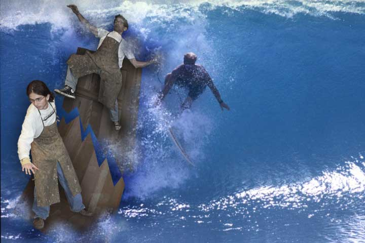 photograph showing charles and ben surfing the waves on a solid wood gate