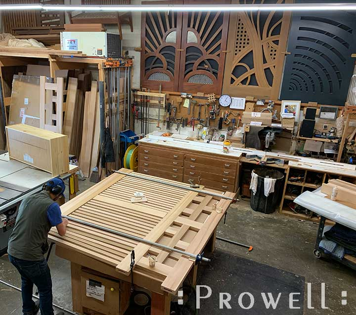 shop progress photograph showing the assembly of the lower pickets to the modern driveway gates #11-1