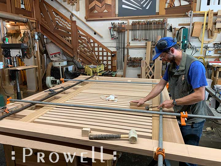 shop progress photograph showing ben prowell aligning the horizontal driveway gates #11-1pickets for the