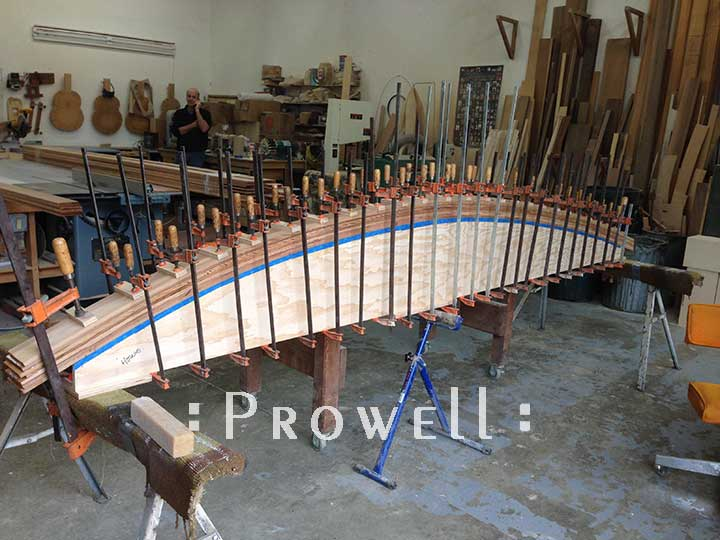laminating arched beams for wood fence style #19-5 in Detroit. prowell woodworks