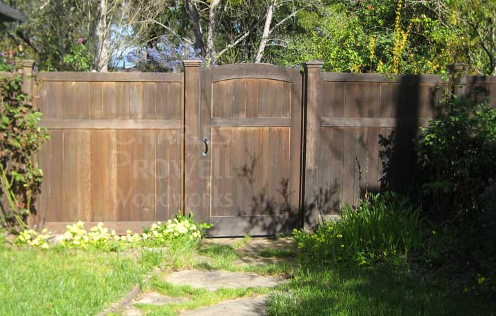 custom wood fence panels weathering to a natural gray