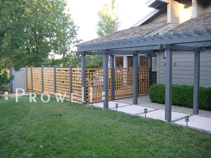 Open grid wood fence panels in Nevada