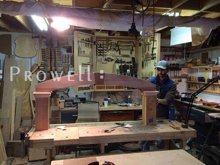 Ben Prowell building the arched wood arbor #9