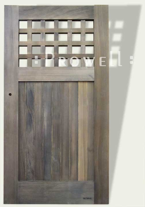cropped photo showing the gate #103-2 with a weathered gray finish.