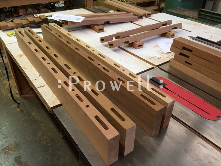 shop photo showing the open mortises for building the entry gate #114