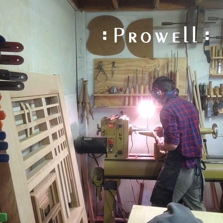 Shop photo showing Ben turning spindles on the lathe for #115,