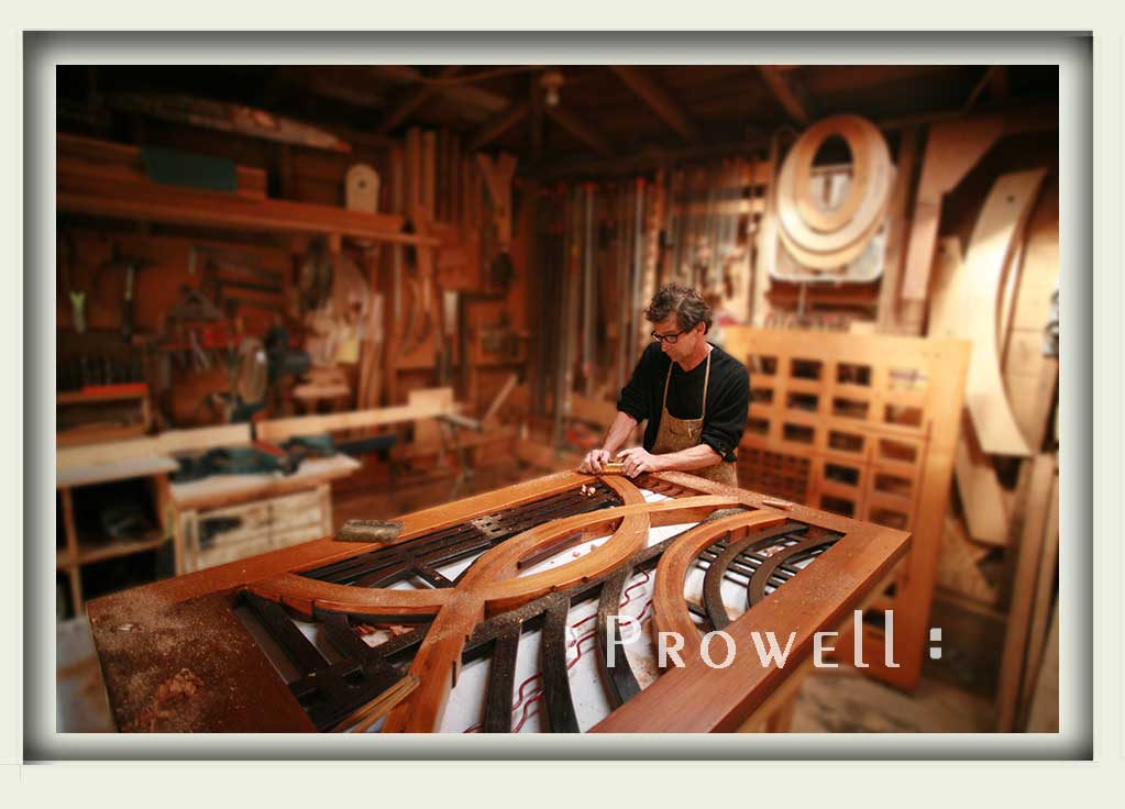 photograph in the shop sowing Charles working on the eccentric gate #200.