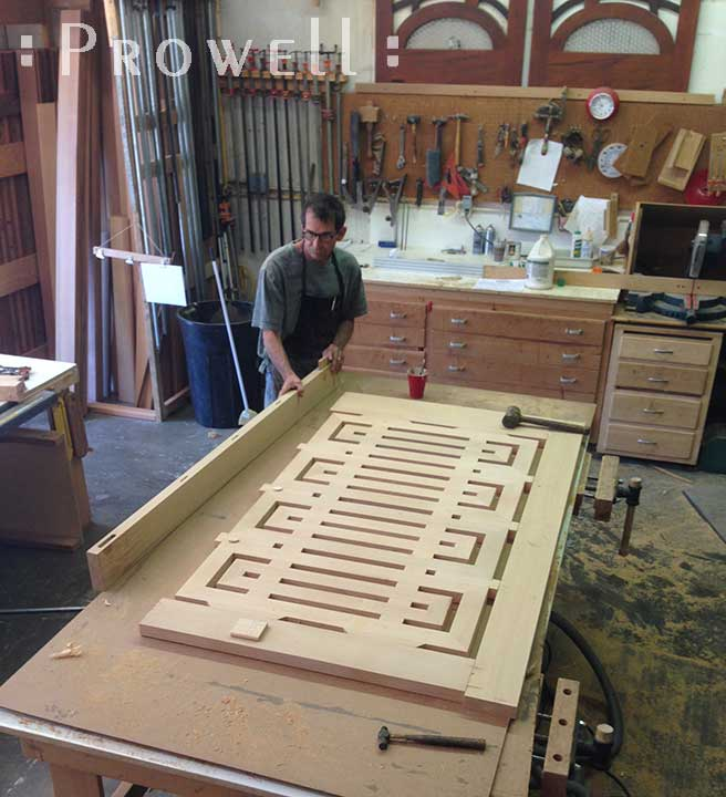 shop progress photograph showing Charles with the final assembly of the postmodern gate #207
