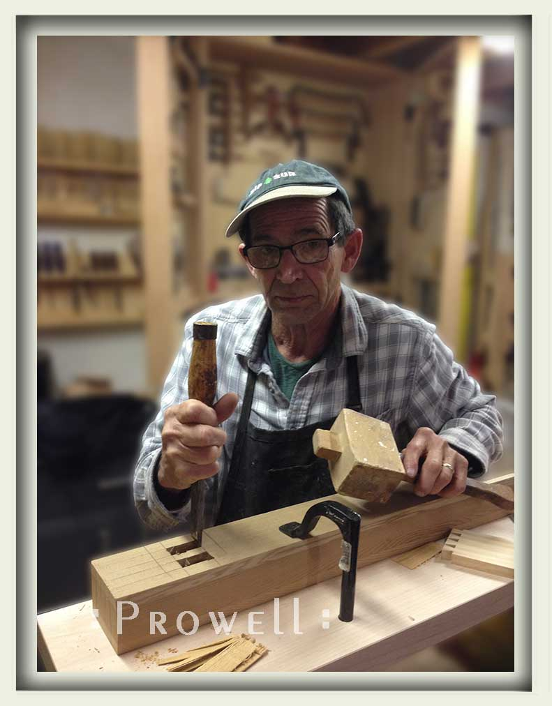 shop photograph showing Charles Prowell hand-cutting a mortise for the artistic garden gates #208