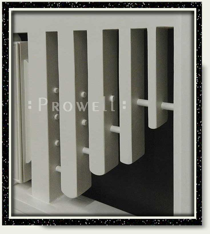 Ccropped photograph showing the receding thickness and dowel stabilizers of modern gate #208