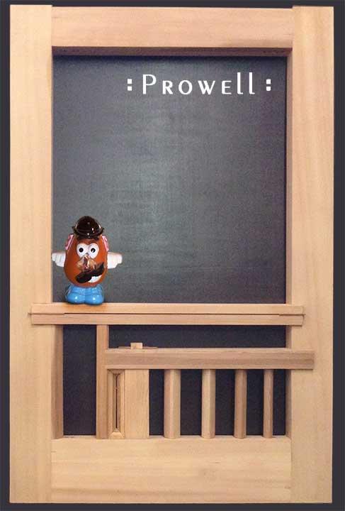 Humorous photo showing the artistic garden gates with Potatohead