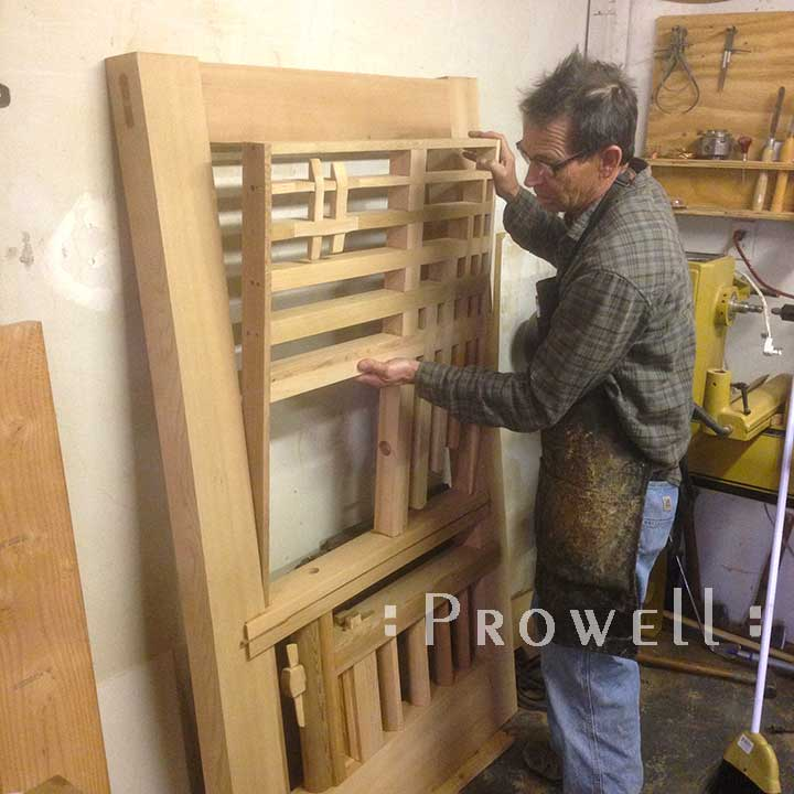 shop photograph showing Charles assembling the upper section to the artistic garden gate #208