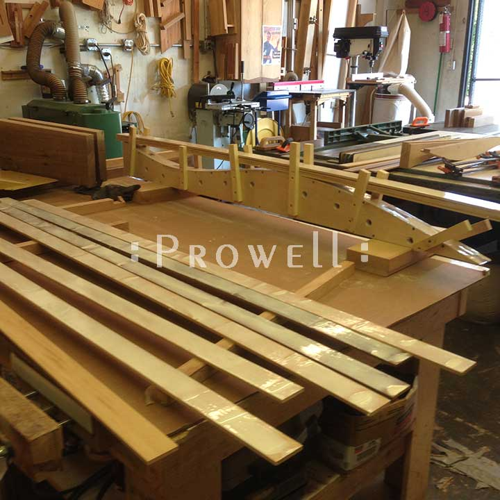 shop progress photograph showing the lamination forms for the modern fence gate #209