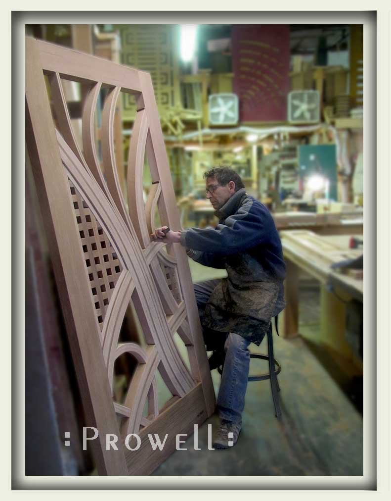 Shop photo showing charles at work on the fancy gate 209.