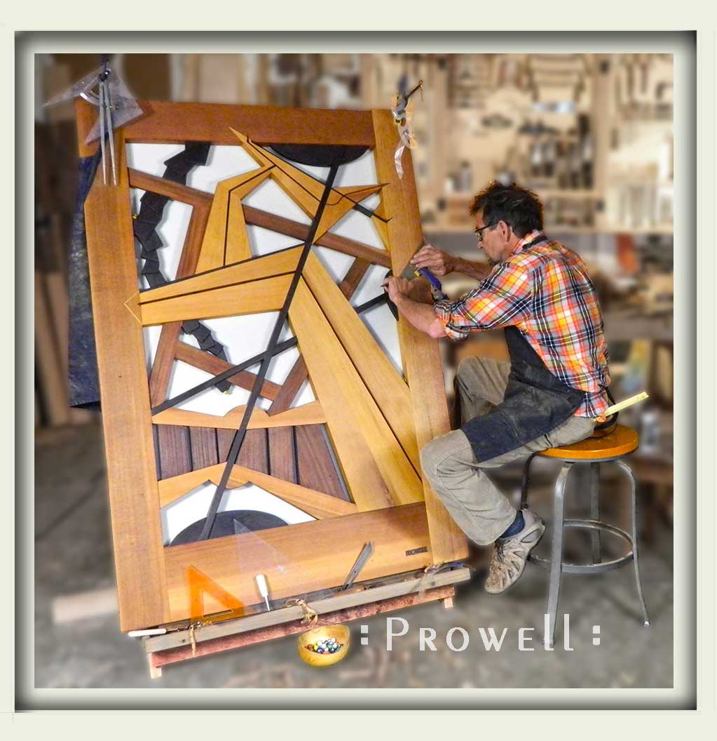 photograph showing charles prowell in the woodshop with the abstract gate design #210