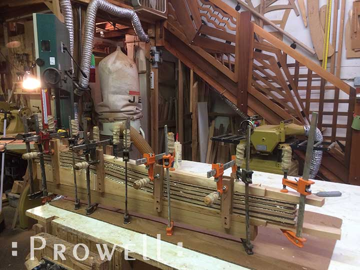 shop progress photo showing the process for laminating curves in with an abstract gate design
