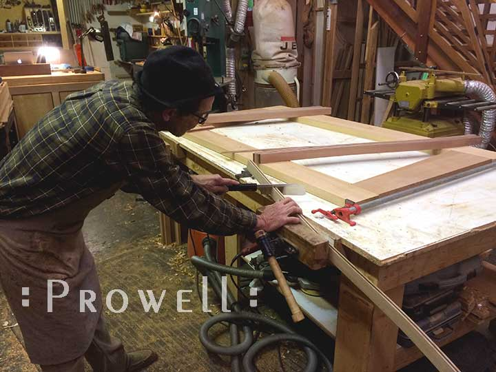 shop progress photo showing charles setting the strings to the eccentric gate design #213