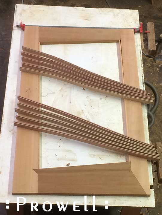 shop progress photograph showing the lamination assembly of the modern gate and fence #213