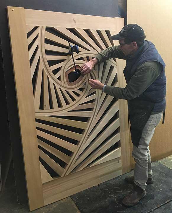 shop photo showing the pinwheel gate design #215 nearly finished.
