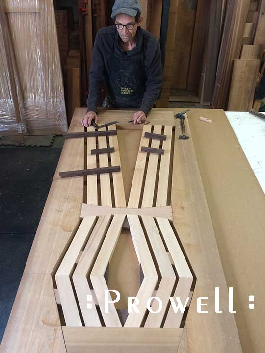 In-progress shop photograph of charles with the wood gate design 216