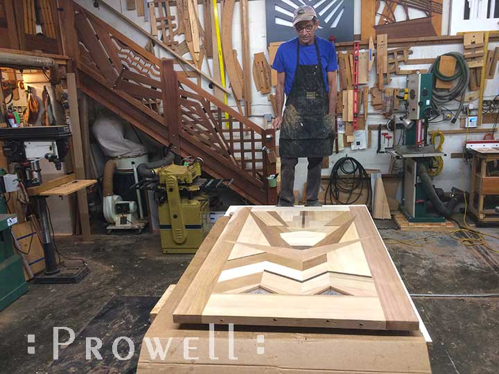 Shop photo showing charles with the nearly completed amazing gate #217