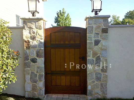photo with stone columns and garden gate #29-13 in Staten Island, NY