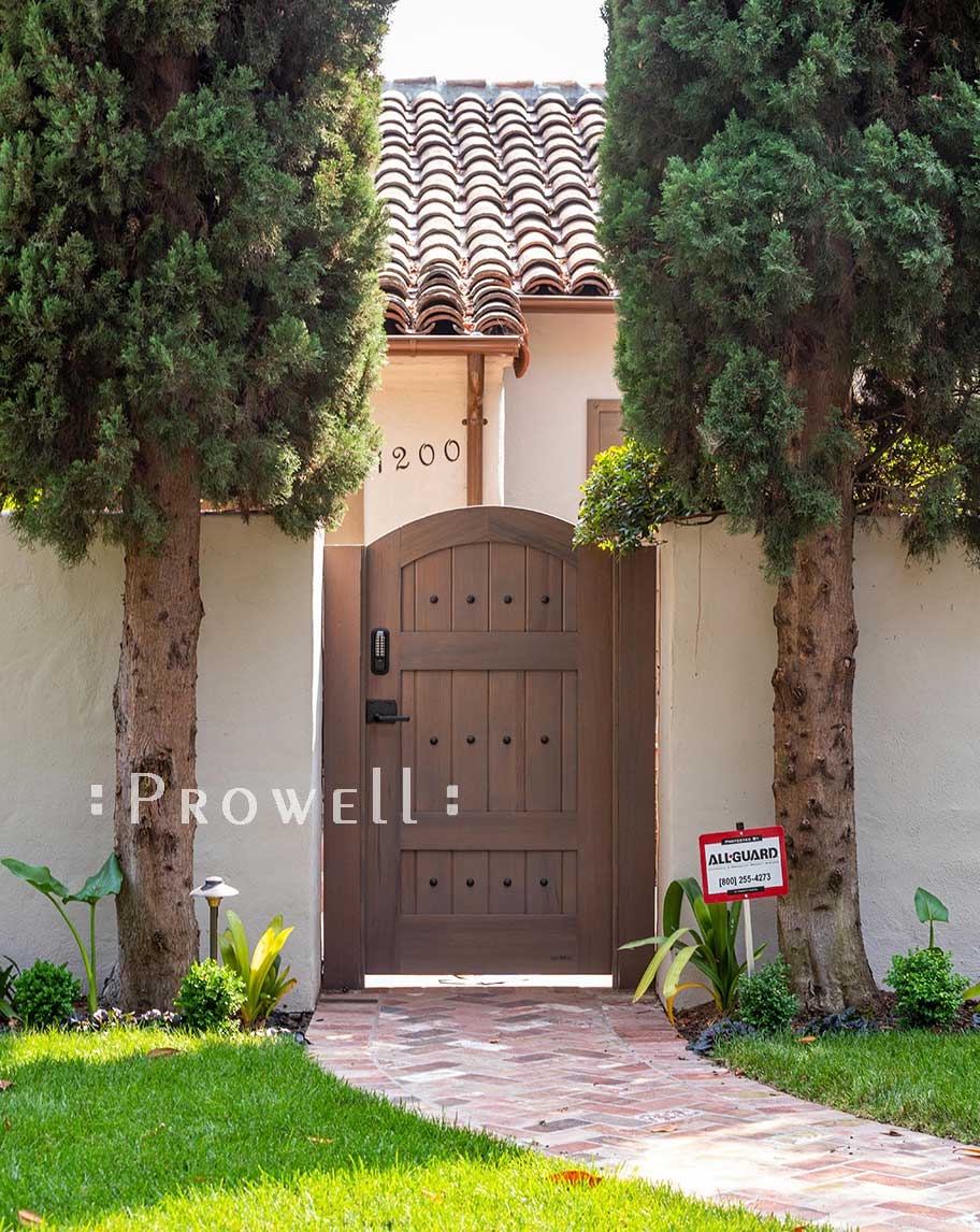 showing the arched gate between stucco pillars in Palo Alto, california