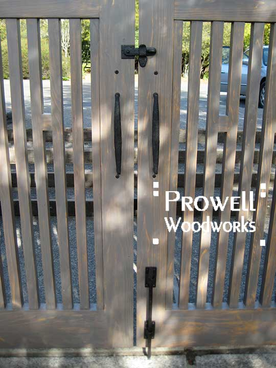 site image showing the property side of wood fence gate #38-1 with the cane bolt, gate pulls, and clasp.