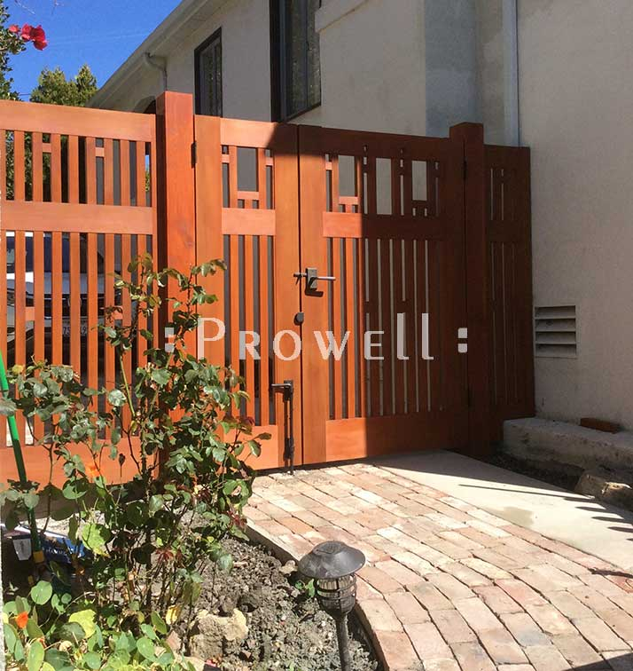 site photograph showing double off-set wood fence gate 38-7 with flanking fence panels in Berkeley, California
