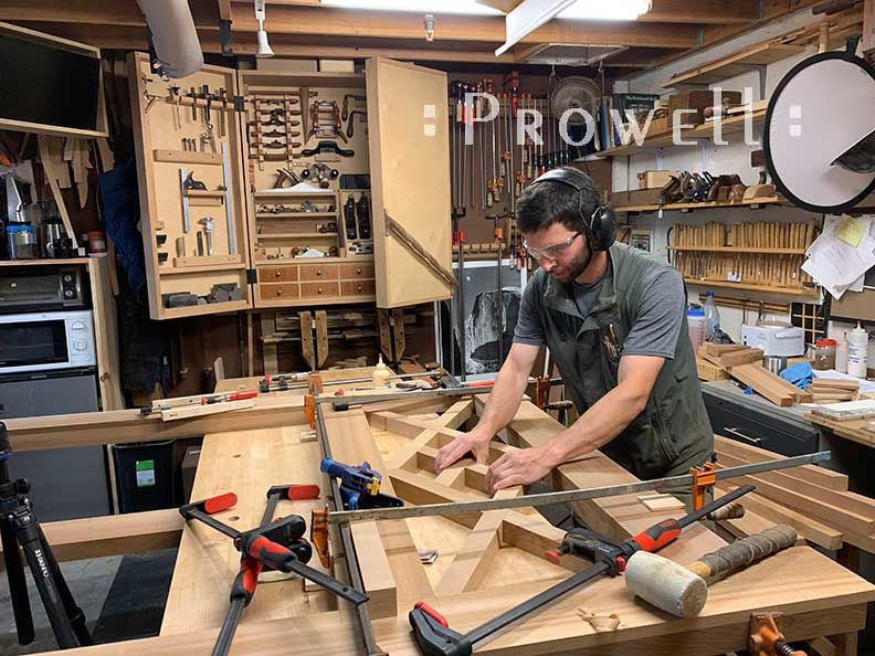 shop photo showing Ben prowell creating the upper pattern for main gate design #39