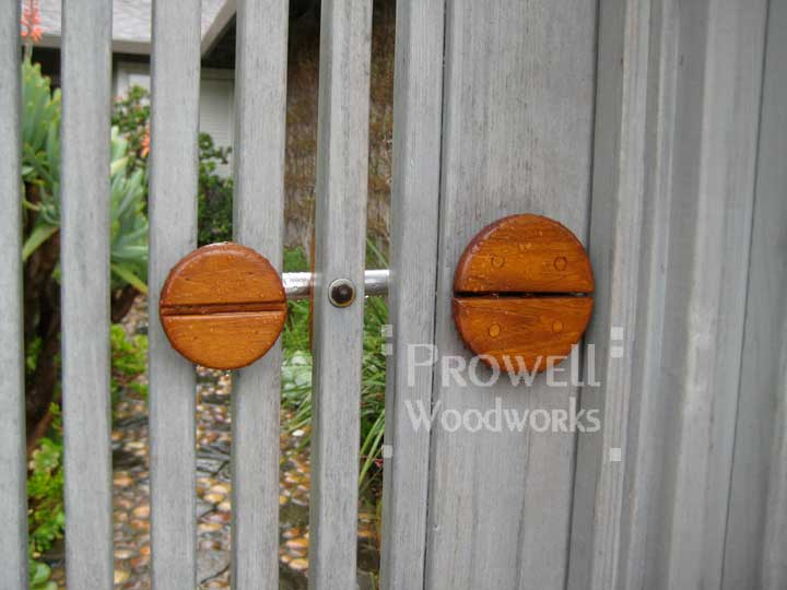 site photo showing Prowell's teak and stainless steel gate latch.