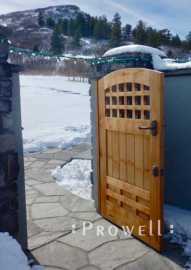 wood gates in Colorado snow. prowell