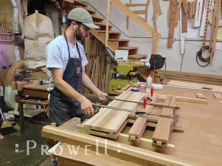 shop photo showing ben prowell gluing up gate 70