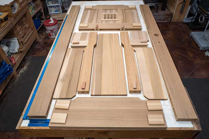 shop photo showing the various parts to wood gate #92 on the workbench