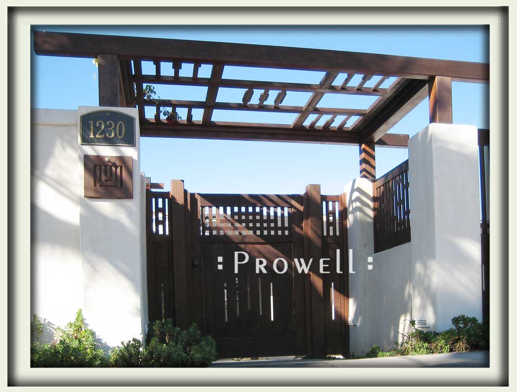 Site photograph showing cedar wood gates #94 with driveway gates and arbor in La Jolla, California