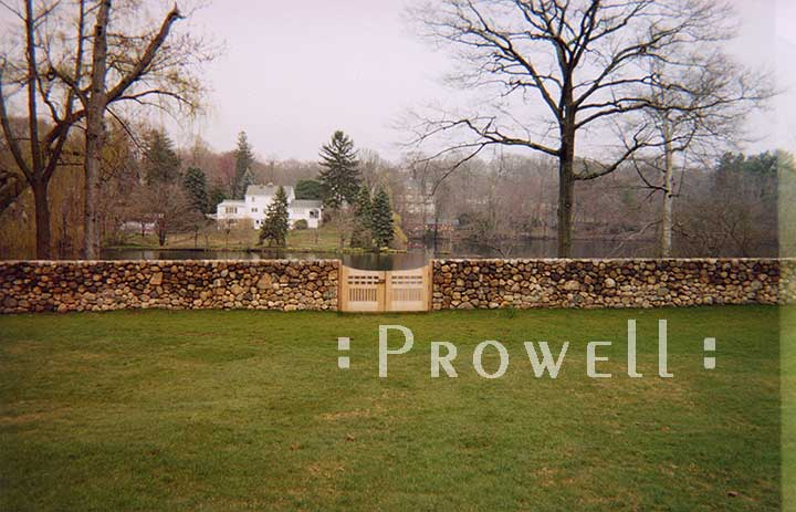 site photograph showing a low stone wall and the arched wooden gates #96=2 in Connecticut