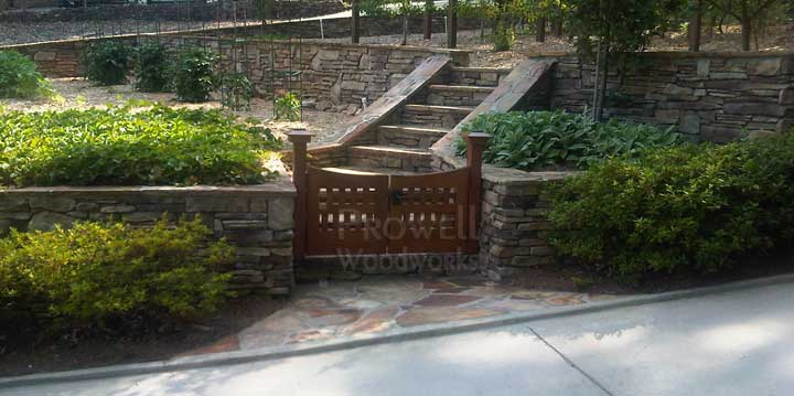 site photograph showing arched wooden gates #96-5 with stone walls in Atlanta, Georgia