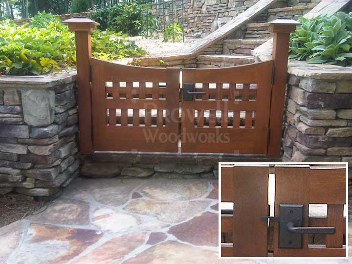 site photograph showing arched wooden gates #96-5 flanked by stone walls in Atlanta, Georgia