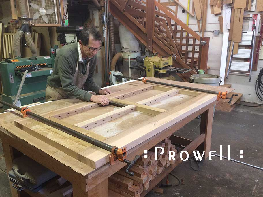 Photograph in the shop showing Charles building the wood gate design #99.