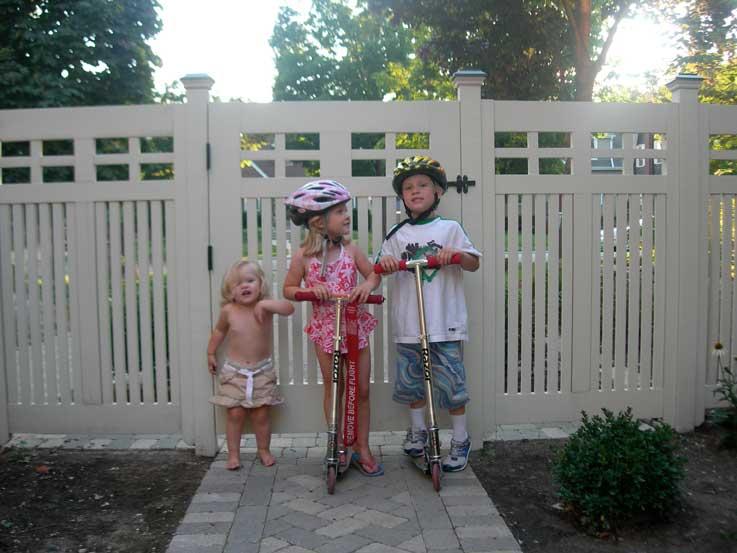 Wood garden gate with children in Chicago